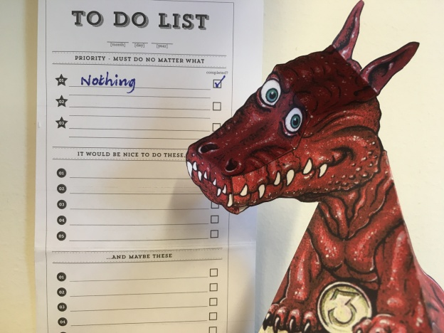 "A paper dragon next to a to-do list, with ""nothing"" checked as the only thing on the list"