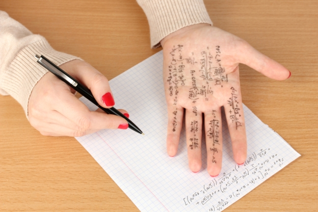 hand with test notes written on it